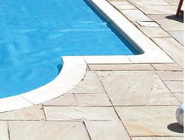 White swimming pool coping stone